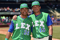 Lexington Legends outfielder Alfredo Escalera-Maldonado (26) and designated hitter Samir Duenez (16) pose for a photo after a game against the Hagerstown Suns on May 19, 2014 at Whitaker Bank Ballpark in Lexington, Kentucky.  Lexington defeated Hagerstown 10-8.  (Mike Janes/Four Seam Images)