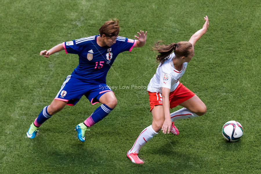 June 8, 2015: Eseosa AIGBOGUN of Switzerland protects the ball during a Group C match at the FIFA Women's World Cup Canada 2015 between Japan and Switzerland at BC Place Stadium on 8 June 2015 in Vancouver, Canada. Sydney Low/AsteriskImages