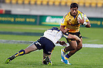 Hurricanes' second five-eighth Cardiff Vaega, right, is tackled by ACT Brumbies' Pat McCabe in the Super Rugby match at Westpac Stadium, Wellington, New Zealand, Friday, March 07, 2014. Credit: Dean Pemberton