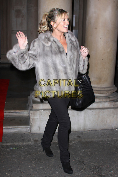 TINA HOBLEY.Tiffany & Co. presents Skate at Somerset House, VIP Opening of the 10th Annual Somerset House Ice Rink, London, England..November 16th, 2009.full length black jacket coat grey gray fur bag purse  jeans denim profile hand waving palm.CAP/AH.©Adam Houghton/Capital Pictures.