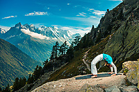 Martina Cufar practicing yoga with  Aiguillette d'Argentiere and Mont Blanc massive in the background.
