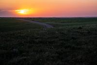 The setting sun in the Flint Hills of Kansas.