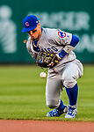 7 October 2017: Chicago Cubs second baseman Javier Baez momentarily bobbles a grounder but still gets the first out in the bottom of the second inning against the Washington Nationals at Nationals Park in Washington, DC. The Nationals defeated the Cubs 6-3 and even their best of five Postseason series at one game apiece. Mandatory Credit: Ed Wolfstein Photo *** RAW (NEF) Image File Available ***