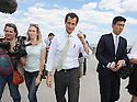 Anthony Weiner  walks on the boardwalk before having lunch on the Far Rockaway Beach Boardwalk on Wednesday, August 14, 2013 in New York. (AP Photo/ Donald Traill)