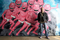 Yue Mingjun, a leading Chinese contemporary artist who is known for his painting and sculptures of large smiling faces, photographed at his studio in Beijing, China.<br /> photo by Qilai Shen / Sinopix