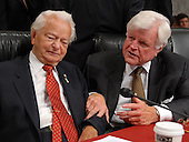 "Washington, D.C. - September 11, 2007 -- United States Senators Robert C. Byrd (Democrat of West Virginia), left,  and Edward M. ""Ted"" Kennedy (Democrat of Massachusetts) share a discussion as they await the testimony of United States Army General David H. Petraeus, Commander of the Multi-National Force - Iraq (MNF-I), and United States Ambassador to Iraq Ryan Crocker on the future course of the war in Iraq during a hearing of the United States Senate Armed Services Committee , Tuesday, September 11, 2007, on Capitol Hill in Washington..Credit: Ron Sachs / CNP.(RESTRICTION: NO New York or New Jersey Newspapers or newspapers within a 75 mile radius of New York City)"