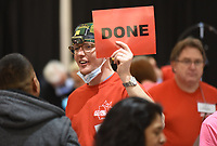NWA Democrat-Gazette/DAVID GOTTSCHALK Dr. Andrew Heath, of Little Rock, holds up a sign Friday, April 12, 2019, notifying volunteers that he has finished with a dental patient and is ready for another during the annual Arkansas Mission of Mercy dental clinic at the Northwest Convention Center in Springdale. The two day clinic continues today 5:30 a.m. to 4:00 p.m.. The clinic offers restoration, extraction and hygiene. The clinic will see more that 2,200 patients. Five hundred dental and medical professional along with an additional 400 volunteers will donate services during the two days.