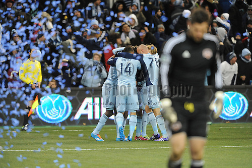 Nov 23, 2013; Kansas City, KS, USA; Sporting KC team members congratulate forward C.J. Sapong (17) after Sapong scores a goal during the first half of the MLS Eastern Conference Championship soccer game against the Houston Dynamo at Sporting Park. Mandatory Credit: Denny Medley-USA TODAY Sports