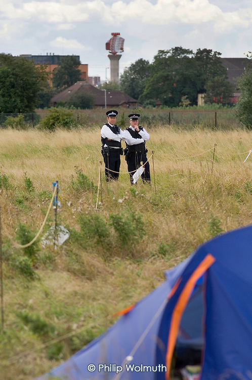 Police observers at the Camp for Climate Action at Heathrow, West London, the world's busiest airport.