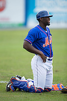Kingsport Mets catcher Darryl Knight (22) stretches in the outfield prior to the game against the Greeneville Astros at Hunter Wright Stadium on July 7, 2015 in Kingsport, Tennessee.  The Mets defeated the Astros 6-4. (Brian Westerholt/Four Seam Images)