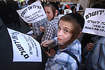 """Ultra-Orthodox children are seen during a two-hour prayer rally and a children's march that was held in the Haredi sections of Jerusalem, Wednesday, July 8, 2009. Today's Prayer Vigil is a continuation of the ongoing """"Sabbath Wars"""" in which the Ultra orthodox community of Jerusalem battle the  municipality decision to open one of the city's parking lots on the Sabbath..Photo By : Emil Salman / JINI"""