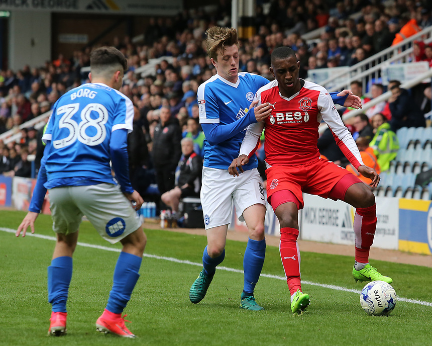 Fleetwood Town's Amari'i Bell holds off the challenge from Peterborough United's Chris Forrester<br /> <br /> Photographer David Shipman/CameraSport<br /> <br /> The EFL Sky Bet League One - Peterborough United v Fleetwood Town - Friday 14th April 2016 - ABAX Stadium  - Peterborough<br /> <br /> World Copyright &copy; 2017 CameraSport. All rights reserved. 43 Linden Ave. Countesthorpe. Leicester. England. LE8 5PG - Tel: +44 (0) 116 277 4147 - admin@camerasport.com - www.camerasport.com