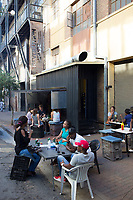 MABONENG, SOUTH AFRICA - MARCH 21: Guests have lunch in a restaurant in Maboneng district on March 21, 2016 in downtown Johannesburg, South Africa. A former derelict industrial area, and a no-go area after dark, it is now a vibrant area with artists, businesses, galleries and tourists. A racially mixed cultural hub with markets on the weekend. Maboneng is the idea of young entrepreneur Jonathan Liebmann, and he owns and controls most of the buildings in the area. (Photo by Per-Anders Pettersson/Getty Images)