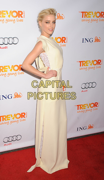 Amber Heard.Trevor Live at The Hollywood Palladium in Hollywood, California, USA..December 4th, 2011.full length dress sleeveless white cream side lace hand on hip.CAP/ROT/TM.©Tony Michaels/Roth Stock/Capital Pictures