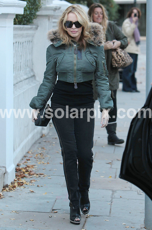 **ALL ROUND PICTURES FROM SOLARPIX.COM**                                             **WORLDWIDE SYNDICATION RIGHTS**                                                                                  Caption:  .Kylie Minouge leaves her home for X-Factor performance on November 7, 2010 in London                                                                                                                                                                        JOB REF:12444        LNJ       DATE: 8.11.2010                                                           **MUST CREDIT SOLARPIX.COM OR DOUBLE FEE WILL BE CHARGED**                                                                      **MUST AGREE FEE BEFORE ONLINE USAGE**                               **CALL US ON: +34 952 811 768 or LOW RATE FROM UK 0844 617 7637**