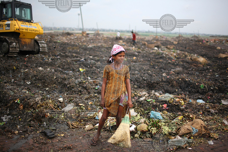 Children collecting rubbish for resale. At the end of each day, they earn TK 55 to 70 (USD 1). The Matuail Dump is one of three waste sites in Dhaka, a city of over ten million people. On average, 5,000 tonnes of waste are dumped at Matuail every day. At least 1,000 people and 150 children are engaged in garbage picking. ....