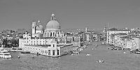 A black and white view from the stern of a cruise ship of the entrance to the Grande Canal in Venice