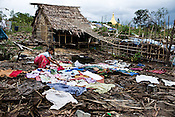 A villager is seen drying the clothes on the grounds where houses once stood. This village is one of the many that were devasted by cyclone Nargis near the city of Thanlyin, 70 kms east of Myanmar's main city Yangon, was devastated by cyclone Nargis when it hit the Irrawaddy delta on May 3 2008, killing tens of thousands. But no help has reached this village in days.