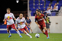 Fabian Espindola (7) of Real Salt Lake is marked by Joel Lindpere (20) of the New York Red Bulls during a Major League Soccer (MLS) match at Red Bull Arena in Harrison, NJ, on September 21, 2011.