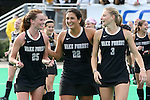 09 November 2014: Wake Forest's Kali Vicars (25), Anna Kozniuk (CAN) (22), and Jess Newak (3) enjoy a moment after the game. The Wake Forest University Demon Deacons played the Syracuse University Orange at Jack Katz Stadium in Durham, North Carolina in the 2014 Atlantic Coast Conference NCAA Division I Field Hockey Championship Game. Wake Forest won the ACC Championship game 2-0.