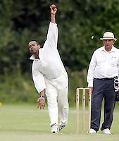 Tuan Hadgie bowls for Harrow during the Middlesex County Cricket League Division Two game between Harrow St Mary's and Shepherds Bush at<br /> Harrow on Sat July 19, 2014