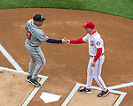 4 April 2014: Atlanta Braves Manager Fredi Gonzalez greets Washington Nationals Manager Matt Williams at home plate during the team introductions prior to the Washington Nationals Home Opening Game at Nationals Park in Washington, DC. The Braves edged out the Nationals 2-1 in their first meeting of the 2014 MLB season. Mandatory Credit: Ed Wolfstein Photo *** RAW (NEF) Image File Available ***