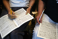 """Southern Arizona Women's Chorus members Mary Walker (MARY WALKER), left, and Dee Ponzio (DEE PONZIO) make notes in their music during a rehearsal at the Grand Hyatt in New York, NY on Friday, June 23, 2006.  The Chorus performed Brusa's """"Missa pro defunctis"""" and Beach's """"The Rose of Avontown, Op. 30"""" at Carnegie Hall on Sunday night."""