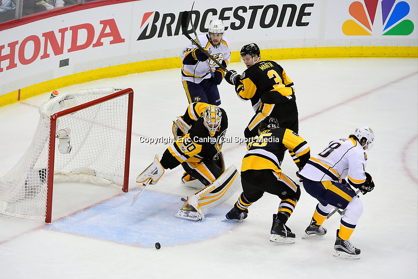 June 8, 2017: Pittsburgh Penguins goalie Matt Murray (30) dives back to protect the net during game five of the National Hockey League Stanley Cup Finals between the Nashville Predators  and the Pittsburgh Penguins, held at PPG Paints Arena, in Pittsburgh, PA. Eric Canha/CSM
