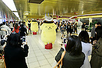 Shinjuku station commuters take pictures to the Sanrio's character Pom Pom Purin or Purin plush dolls displayed along in the Tokyo Metro Promenade on March 8, 2016, Tokyo, Japan. 11 of the huge cuddly characters will be displayed in an underground passage of Shinjuku Station until March 13, as a part of the celebrations for the 20th Birthday of Pom Pom Purin. Sanrio is a Japanese company established in 1963, which has created over 400 cute characters, including the worldwide known Hello Kitty. (Photo by Rodrigo Reyes Marin/AFLO)