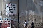 A graffiti celebrating the 60th anniversary of Caritas Baby Hospital, drawn on the separation wall in Bethlehem, West Bank.