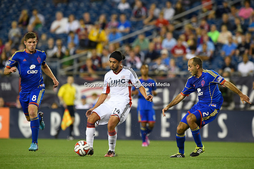 July 30, 2014 - Foxborough, Massachusetts, U.S. - New England Revolution's Andrew Farrell (2) controls the ball between Colorado Rapids' Dillon Powers (8) and Nick LaBrocca (2) during the MLS game between the Colorado Rapids and the New England Revolution held at Gillette Stadium in Foxborough Massachusetts. The New England Revolution defeated the Colorado Rapids 3-0. Eric Canha/CSM