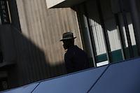 JOHANNESBURG, SOUTH AFRICA - JULY 20:  A man walks on  the street in Johannesburg, South Africa.  (Photo by Landon Nordeman)