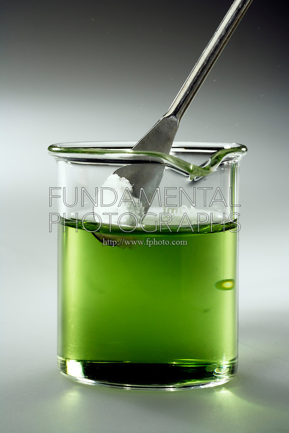 PHOSPHORUS PENTOXIDE ACIDIFIES WATER<br /> (2 of 7 - Variations Available)<br /> Universal Indicator with P4O10 (s)  and Water<br /> The P4O10 is t added to a beaker of water whose pH is shown as neutral (green) by the presence of universal indicator