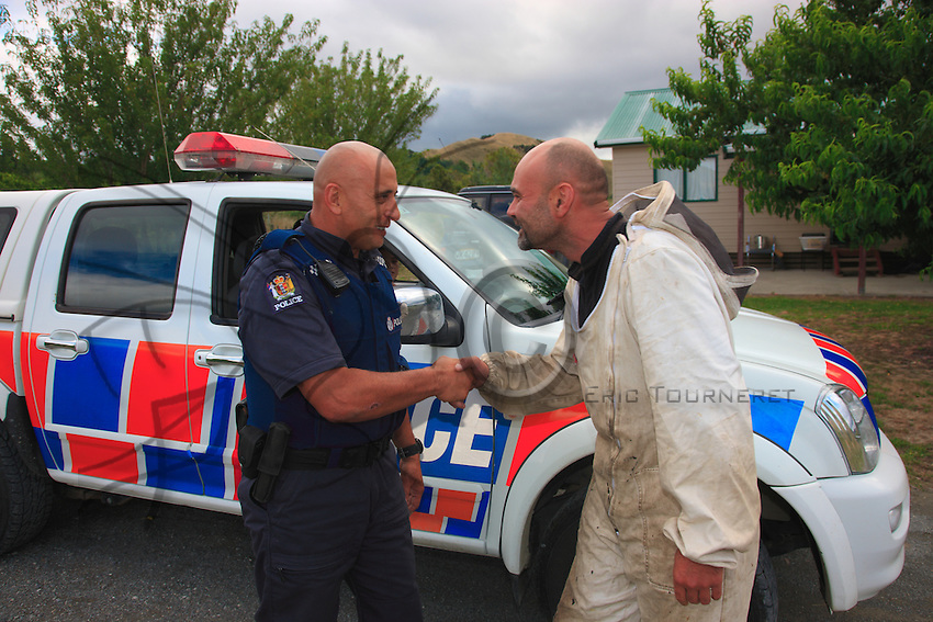 With a Hongi, Norman greets the Ruatoria policeman who has come to ask him for a favor: clear the street of a hive, and its, bees fallen from a beekeeper's truck.