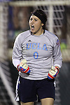 06 December 2013: UCLA goalkeeper Katelyn Rowland celebrates after making a save during the penalty kick shootout. The University of California Los Angeles Bruins advanced over the University of Virginia Cavaliers in penalty kicks following a 1-1 tie at WakeMed Stadium in Cary, North Carolina in a 2013 NCAA Division I Women's College Cup semifinal match.