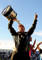Nov 13, 2010; Pomona, CA, USA; NHRA pro stock driver Greg Anderson celebrates after clinching the 2010 pro stock championship during qualifying for the Auto Club Finals at Auto Club Raceway at Pomona. Mandatory Credit: Mark J. Rebilas-