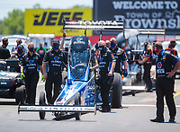 Jul 11, 2020; Clermont, Indiana, USA; NHRA top fuel driver Tony Schumacher and crew during qualifying for the E3 Spark Plugs Nationals at Lucas Oil Raceway. This is the first race back for NHRA since the start of the COVID-19 global pandemic. Mandatory Credit: Mark J. Rebilas-USA TODAY Sports