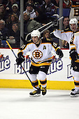 February 17th 2007:  Marc Savard (91) of the Boston Bruins celebrates the game winning goal vs. the Buffalo Sabres at HSBC Arena in Buffalo, NY.  The Bruins defeated the Sabres 4-3 in a shootout.