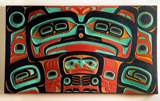 Northwest coast wall carving by Tlingit master carver Nathan Jackson with a totem design of a bear
