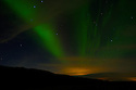 The Northern Lights (Aurora Borealis) above the countryside, outside Reykjavik.