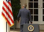 United States President George W. Bush departs after holding a full press conference in the Rose Garden of the White House in Washington, DC on July 30, 2003.  He took questions for almost an hour on a variety of questions including Iraq, tax cuts, and the upcoming election.<br /> Credit: Ron Sachs / CNP