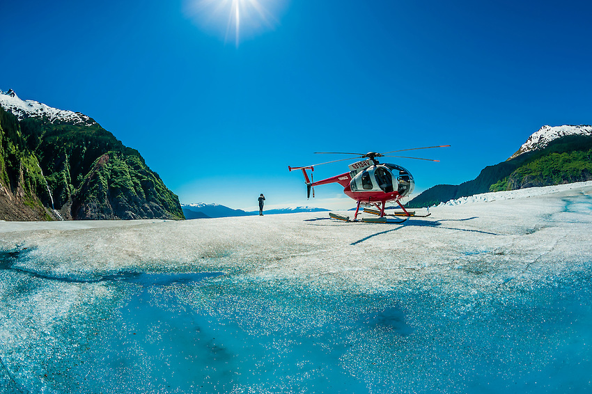 Helicopter and meltwater pools on the Mendenhall Glacier, near Juneau, Alaska USA.