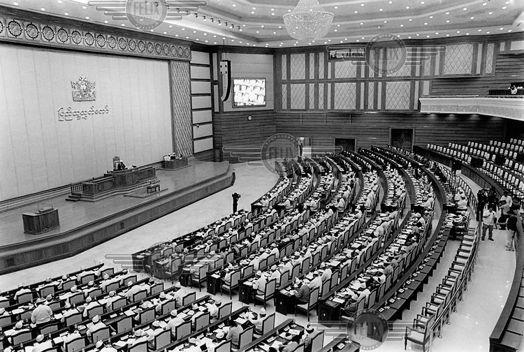 The Pyithu Hluttaw, or lower house of Burma's parliament where, in 2012, Aung San Suu Kyi and several members of the National League for Democracy were sworn in. Parliament is dominated by former soldiers, their positions guaranteed under a constitution which was ratified after a fraudulent referendum in 2008. A quarter of parliamentary seats have gone to military personnel. Most senior ministerial posts are held by former generals, including the new president, Thein Sein. The Union Solidarity and Development Party, a proxy for the military and its supporters, holds most positions. The government moved the capital from Rangoon (Yangon) in November 2005. /Felix Features