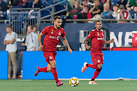 FOXBOROUGH, MA - AUGUST 31: Nicolas Benezet #7 of Toronto FC on the attack during a game between Toronto FC and New England Revolution at Gillette Stadium on August 31, 2019 in Foxborough, Massachusetts.