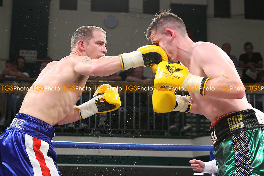 Peter McDonagh (green/black shorts) defeats Johnny Greaves (blue shorts) in a Light-Welterweight Boxing Contest at York Hall, Bethnal Green, promoted by Queensberry Promotions - 30/09/11 - MANDATORY CREDIT: Gavin Ellis/TGSPHOTO - Self billing applies where appropriate - 0845 094 6026 - contact@tgsphoto.co.uk - NO UNPAID USE.
