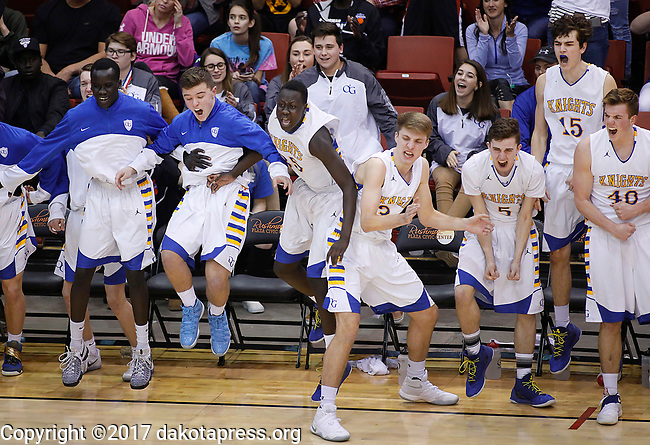 RAPID CITY, SD - MARCH 18, 2017 -- Players on the Sioux Falls O'Gorman bench celebrate after a score against Aberdeen Central during the 2017 South Dakota State Class AA Boys Basketball Championship game Saturday at Barnett Arena in Rapid City, S.D.  (Photo by Dick Carlson/Inertia)