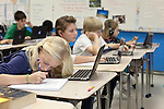 November 15, 2011. Mooresville, NC..  Haley Gill, 10, a 5th grader at East Mooresville Intermediate School, works on an in class science lesson. Students are required to bring pencils, as well as their school issued laptop and head phones to every class.. The Mooresville school system has become nationally known for being on the cutting edge of using technology as an educational tool. Starting in 3rd grade, each student is issued their own laptop that they will use in class and at home to further their learning.