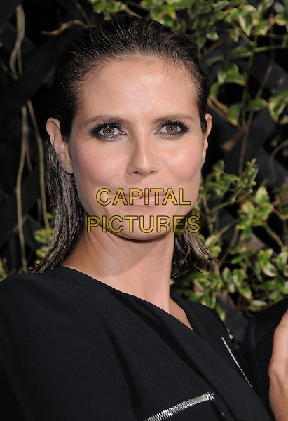 HEIDI KLUM.The Eva by Eva Longoria Fragrance Launch held at Beso in Hollywood, California, USA. .April 27th, 2010.perfume headshot portrait black eyeliner make-up wet hair slicked back.CAP/RKE/DVS.©DVS/RockinExposures/Capital Pictures.
