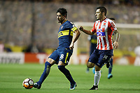 "BUENOS AIRES - ARGENTINA - 04 - 04 - 2018: Pablo Perez   (Izq.) jugador de Boca Juniors disputa el balón con Leonardo Pico (Der.) jugador de Atletico Junior, durante partido de la fase de grupos, grupo H, fecha 2, entre Boca Juniors (ARG) y Atletico Junior (Col) por la Copa Conmebol Libertadores 2018, jugado en el estadio Alberto J. Armando ""La Bombonera""  de la ciudad Ciudad Autónoma de Buenos Aires. / Pablo Perez   (L) player of Boca Juniors vies for the ball with Leonardo Pico (R) player of Atletico Junior, during a match of the groups phase, group H, of the 2nd date between Boca Juniors (ARG) and Atletico Junior (Col), for the Copa Conmebol Libertadores 2018 at the Alberto J. Armando ""La Bombonera"" Stadium in Ciudad Autónoma de Buenos Aires. Photo: VizzorImage / Javier Garcia Martino / Photogamma / Cont."