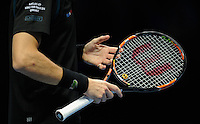 The Paris Peace logo dampener on the strings of Nicolas Mahut (FRA) during Day Six of the Barclays ATP World Tour Finals 2015 played at The O2, London on November 20th 2015